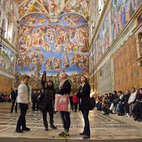 Group looking at the Sistine Chapel's ceiling