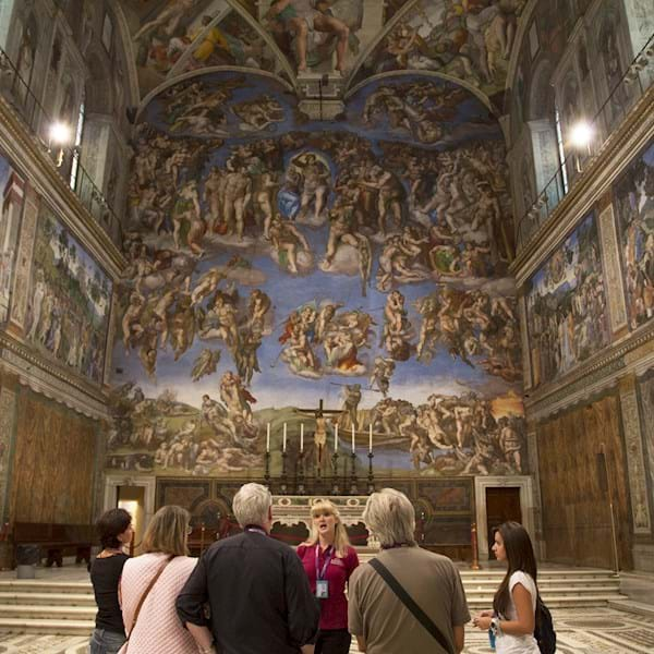 Group watching the Last Judgement in Sistine Chapel