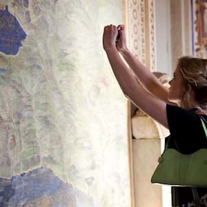 Girl taking a picture of the maps room