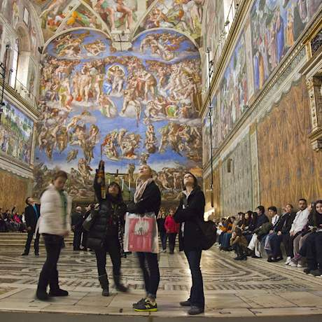 Group looking at Sistine Chapel's ceiling