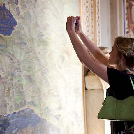 Girl looking at the maps room