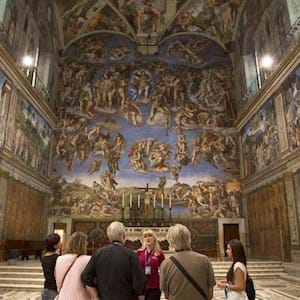 Group looking at the Last Judgement in Sistine Chapel