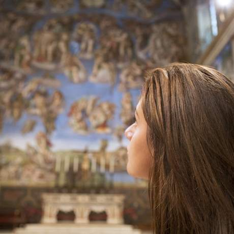 Girl looking at the Last Judgement in Sistine Chapel