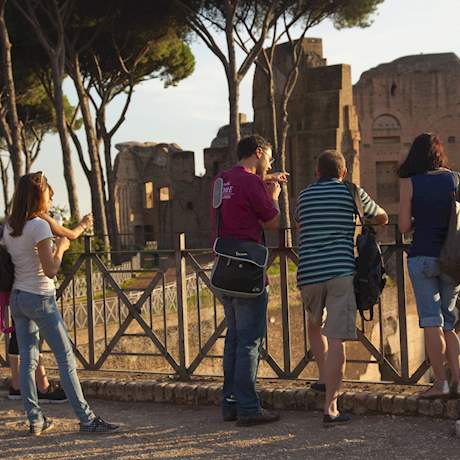 Guide explaining to the group on Palatine Hill