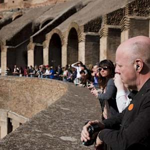 Group staring at the interior of the Colosseum