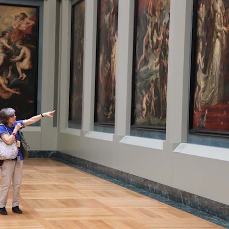 Guide Pointing at  Louvre's Painting