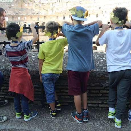 Kids looking at the Colosseum