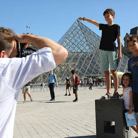 Kids and the Pyramid of Louvre Museum