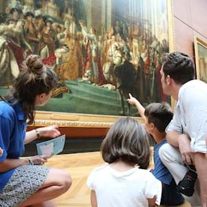 Guides and Family Looking at Louvre's painting