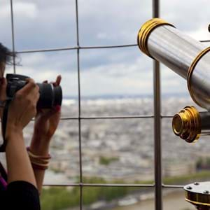 Girl taking photo from eiffel tower