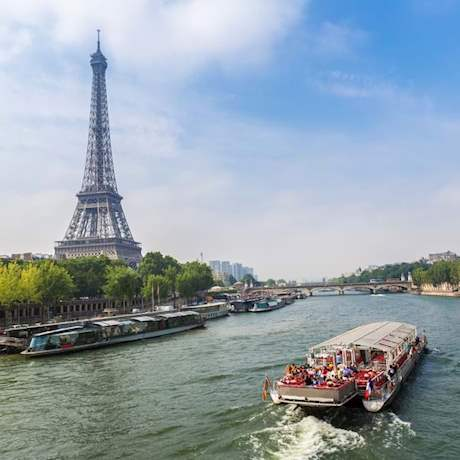 Boat on Seine River in background Eiffel Tower