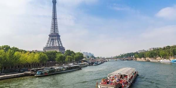 Tour boat on Seine with Eiffel tower