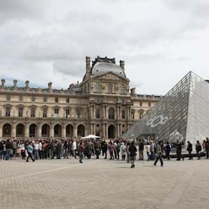 louvre museum pyramid with people