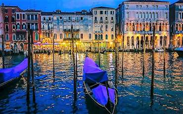 venice canal with gondola at night