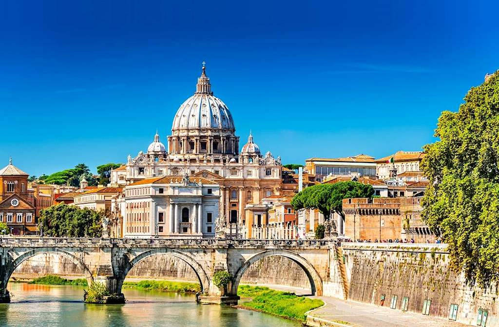 Saint Peters Basilica from the Tiber river with Ponte Sant'Angelo