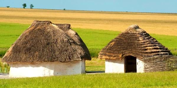 Neolithic houses built at Stonehenge in a sunny day